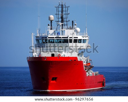 Rescue Standby vessel underway at sea over blue sky and sea. - stock photo