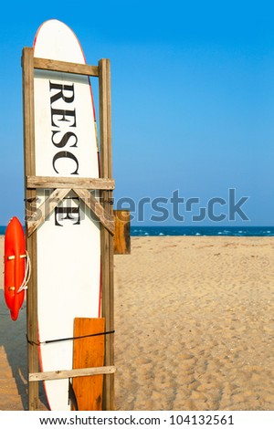 Rescue surfboard on the beach.  Copy space - stock photo