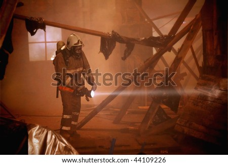 Rescuer search an accident victim in a smoke - stock photo