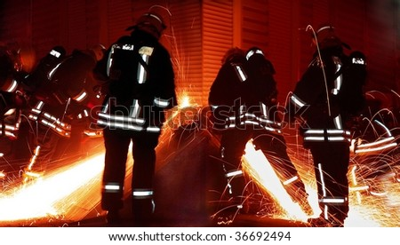 Rescuers team at night - stock photo