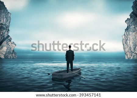 Research concept with businessman in boat in the middle of the sea and lightly cloudy skies