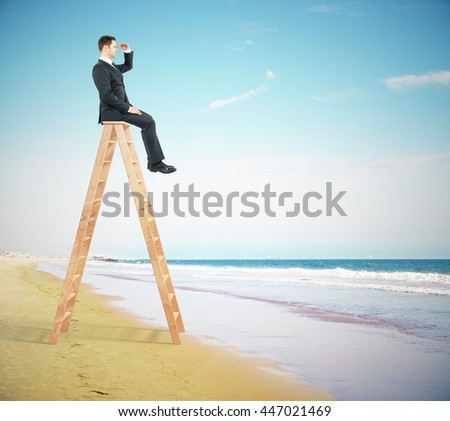 Research concept with businessperson sitting on ladder top and looking into the distance on the beach - stock photo