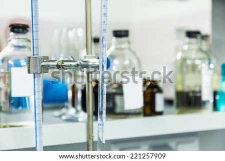 Research laboratory glass measuring equipment - stock photo