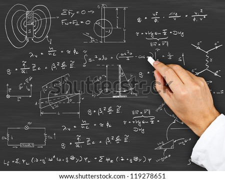 Research scientist writing physics diagrams and formulas with chalk on blackboard - stock photo