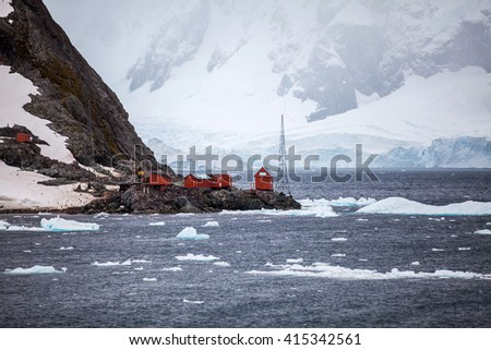 Research station on shore in Antarctica - stock photo