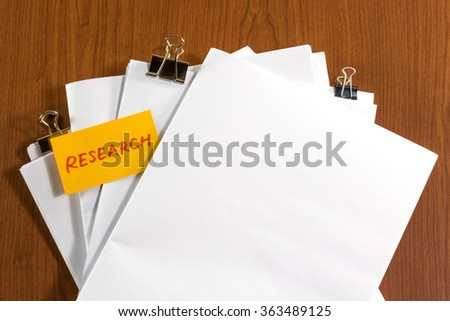 Research; White Blank Documents with Small Message Card. - stock photo