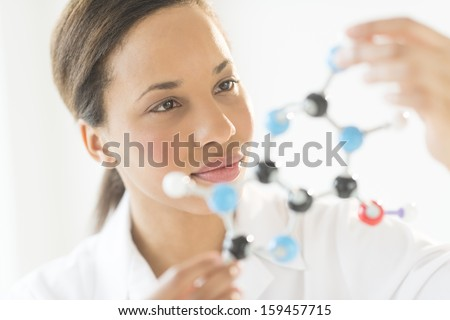Researcher examining molecular structure in laboratory - stock photo