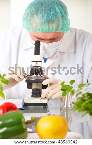 Researcher holding up a GMO vegetable. Genetically modified organism or GEO here transgenic plant is an plant whose genetic material has been altered using genetic engineering techniques - stock photo