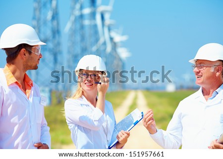 researchers at work  on wind power station - stock photo