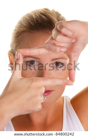 researchers by a frame of fingers. white backgroubnd - stock photo