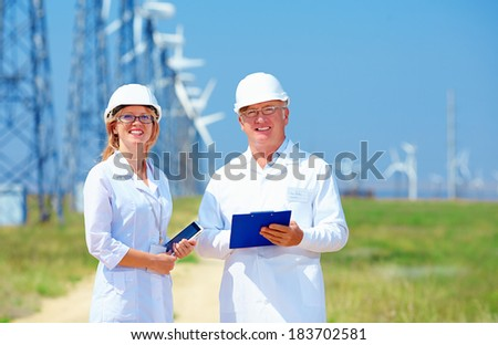 researchers on wind power station - stock photo