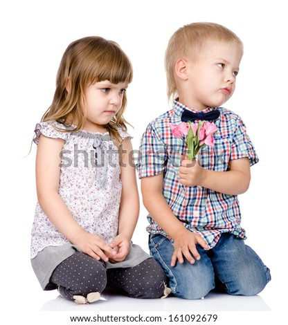 resentful boy gives to the girl a flower. isolated on white background - stock photo