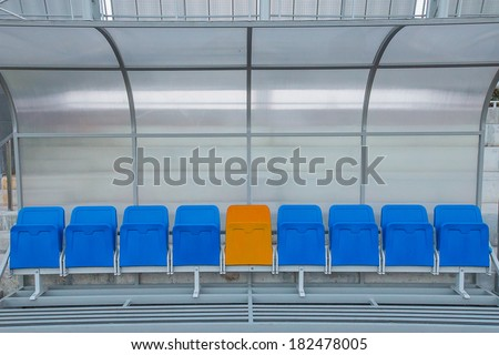 Reserve and staff coach bench in sport stadium - stock photo
