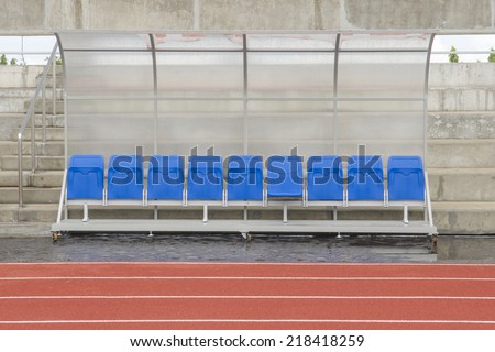 Reserve chair and staff coach bench in sport stadium - stock photo