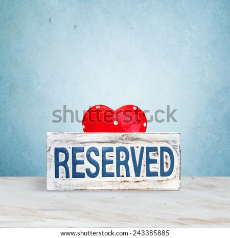 reserve signboard and heart - stock photo