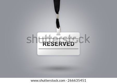 reserved on badge with grey radial gradient background - stock photo