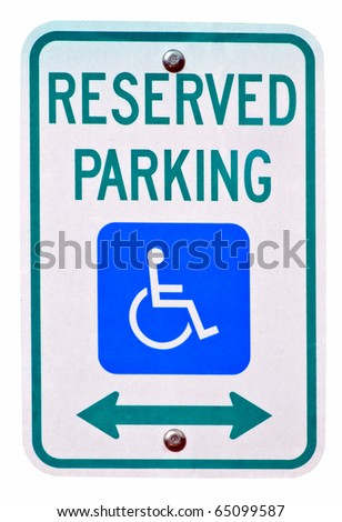 Reserved parking sign for persons with disabilities, used to give close access to store and business entrances. - stock photo