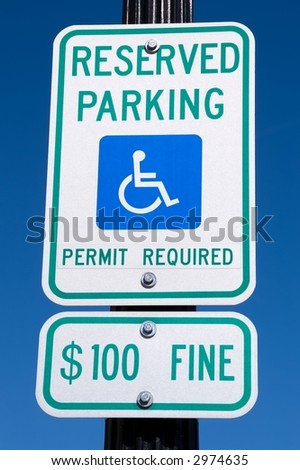 Reserved parking sign for vehicles with handicap permits - stock photo
