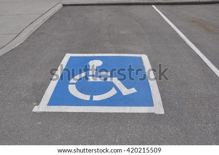 Reserved parking space for handicapped person - stock photo