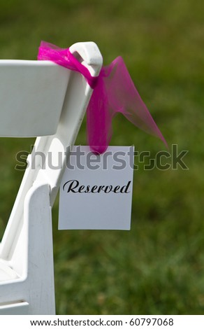 Reserved seat at an outdoor wedding ceremony - stock photo