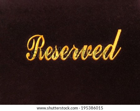 Reserved sign isolated on dark background / reservation concept in restaurant / church / hall / museum / doctor's office / movie theater - stock photo