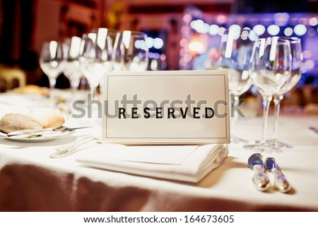 Reserved sign on a table in restaurant - stock photo