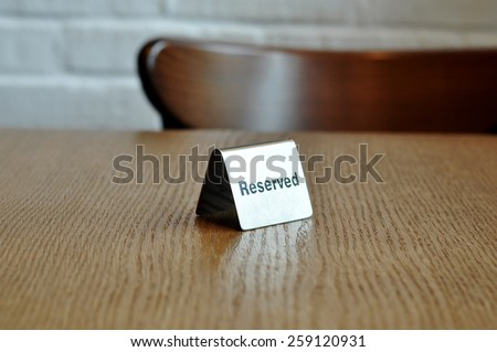 Reserved - sign on the wood table at the cafe - stock photo