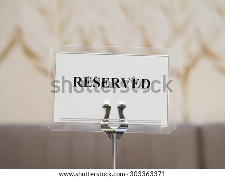 Reserved sign with holder in restaurant - stock photo