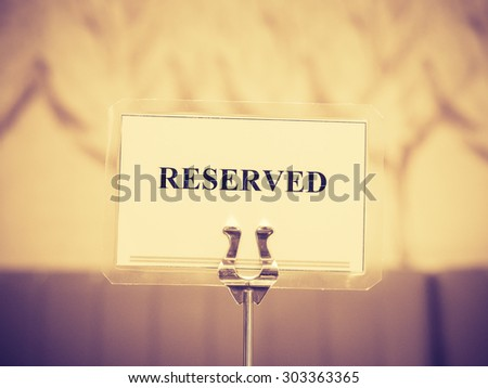 Reserved sign with holder in restaurant, Vintage style - stock photo