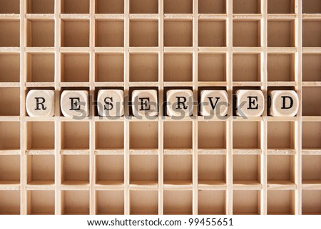 Reserved word construction with letter blocks / cubes and a shallow depth of field - stock photo