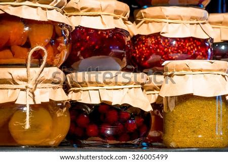 reserves jam from fresh berries on the shelf - stock photo
