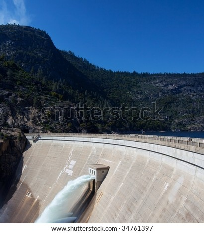 Reservoir Dam with Flowing Water - stock photo