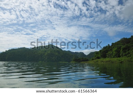 Reservoir in the valley due to dam. - stock photo