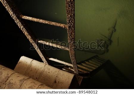 Reservoir of sludge - underground historical sewage treatment plant in Prague. - stock photo