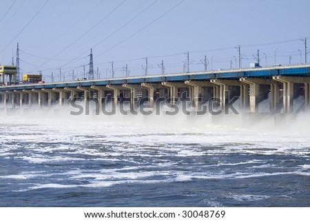 Reset of water on hidroelectric power station on river - stock photo