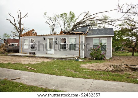 Residence a week after being struck by a tornado.  Some clean up has been completed. - stock photo