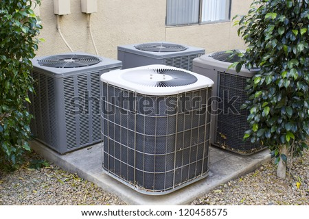 Residential air conditioner compressor units near building - stock photo