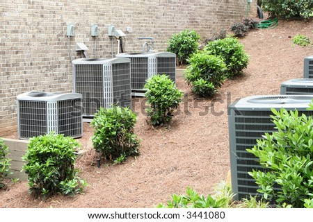 Residential air conditioning units for a large home.  Environmental control. - stock photo