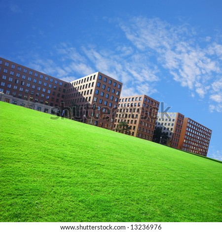 residential area in the city with grass field - stock photo