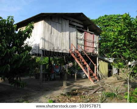 Residential building in the Amazon rainforest, near Presidente Figueiredo, Brazil - stock photo