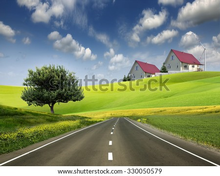 Residential building in the green meadows and the road - stock photo