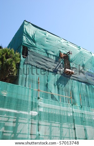 residential building under construction (blue sky background) - stock photo