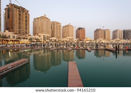 Residential buildings and empty Marina at The Pearl in Doha, Qatar - stock photo