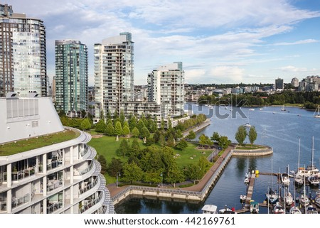 Residential Buildings in Downtown Vancouver by the public park with a beautiful view on False Creek.