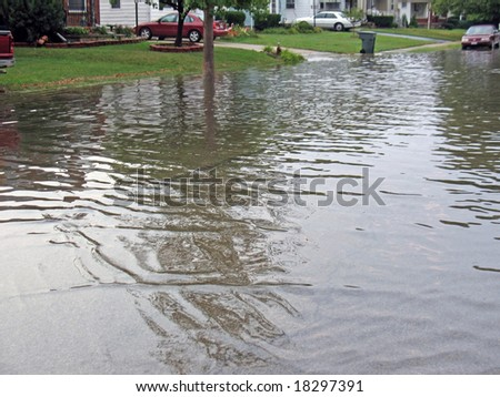 residential city street flooded after heavy rain - stock photo