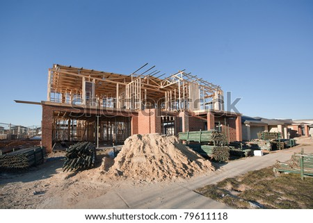 Residential construction site with partially completed home