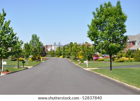 Residential District Suburban Neighborhood Street in Spring - stock photo