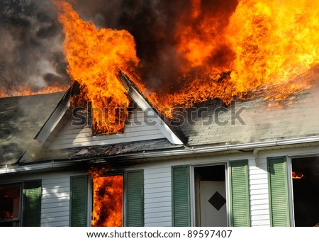 residential fire, fully involved - stock photo