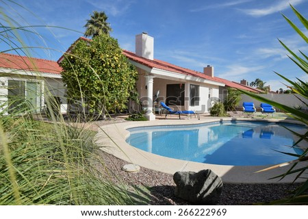 Residential home backyard with pool - stock photo