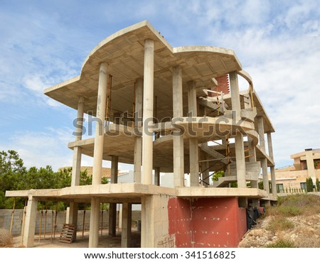 Residential Home Cement and Brick Foundation Structure Construction Site blue sky clouds - stock photo